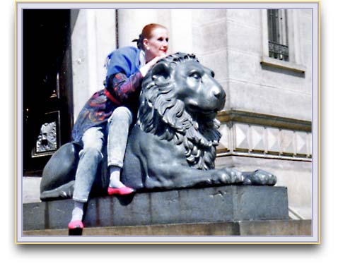 Ulrike sitting on old cast iron lion.