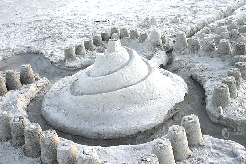 A sandcastle seemingly made from sugar.