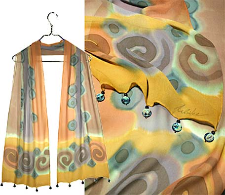 Ulrike Scarves with rich mustard and turquoise tones and abalone round drops on the hem.