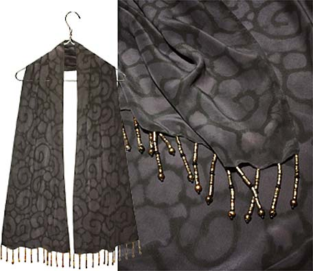 Night swirling over this Ulrike scarf embellished with long reflecting beads.